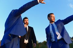 Company leaders show worksite. Board of executives take a walk. Outside. Business, confidence and teamwork concept. Businessmen with smiling faces in formal royalty free stock photos