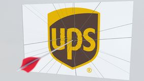 Archery arrow breaks glass plate with UPS company logo. Business issue conceptual editorial 3D rendering. Company logo being hit by archery arrow. Business stock illustration