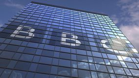 BBC logo against modern building reflecting sky and clouds, editorial animation. Company logo made against sky background, conceptual editorial 3D stock footage