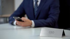 Company male CEO reading financial market news on mobile phone, business royalty free stock images