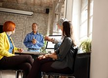Company manager making business plan with workers group. Afro-American company manager making business plan with female workers group royalty free stock photography