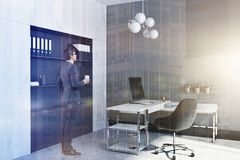 Company manager office corner, man. Manager office interior with a large window, a table with a chair and a computer on it. A bookcase. A businessman 3d royalty free stock photos