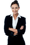 Company manager posing with arms crossed. Smiling confident female business executive royalty free stock photos