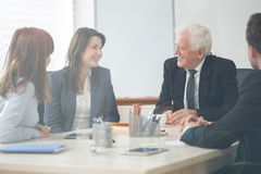 Company meeting. Four elegant businesspeople on company meeting Stock Images