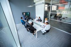 Company meeting with manager in meeting room. Company meeting with manager and employees in meeting room royalty free stock photos
