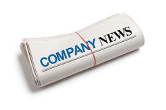 Company News. Newspaper roll with white background Royalty Free Stock Photo