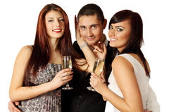 The company at the party. Man in the company of two women at a party Royalty Free Stock Photos
