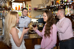 Company of people at a bar Stock Photography
