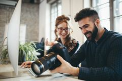 Company photo editor and photographer working together Royalty Free Stock Photography