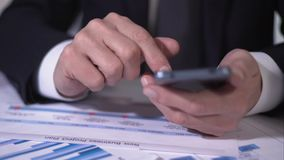 Company president sending message to business partner on smartphone, closeup. Stock footage stock footage