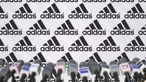 Media event of ADIDAS, press wall with logo and microphones, editorial 3D rendering stock photo