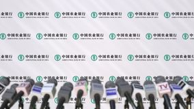 News conference of AGRICULTURAL BANK OF CHINA, press wall with logo as a background and mics, editorial 3D rendering stock images