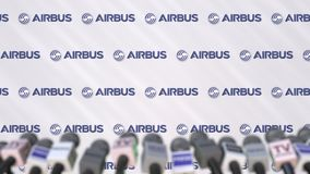 Press conference of AIRBUS, press wall with logo and microphones, conceptual editorial 3D rendering royalty free stock photography