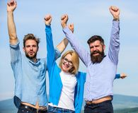 Company reached top. Company of three happy colleagues or partners celebrating success, sky background. Success concept. Men with beard in formal shirts and Royalty Free Stock Photo