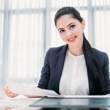 Company recruiter business hr office manager job. Company recruiter. young professional business hr. female office manager holding a paper with resume or job royalty free stock image