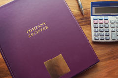 Company Register documents with pen and calculator Royalty Free Stock Photography