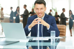 Company representative at the Desk on office background Stock Photography