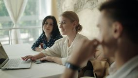 A representative of the wedding planners, talking with clients about the organization`s upcoming wedding in a cozy stock footage