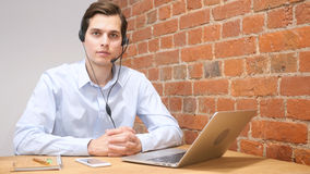 Company Representative using headset to talk on the hot line Royalty Free Stock Images