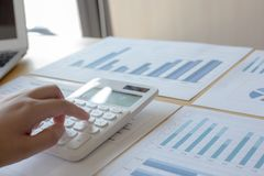 The company`s female accountant is checking the company`s financial account royalty free stock photos