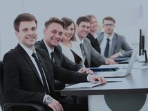 Company`s shareholders at the meeting sitting behind a Desk with Royalty Free Stock Photography