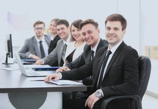 Company`s shareholders at the meeting sitting behind a Desk with Royalty Free Stock Photo