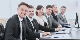 Company`s shareholders at a meeting at work, sitting at a table Stock Photos