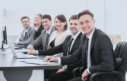 Company`s shareholders at a meeting at work, sitting at a table Royalty Free Stock Image