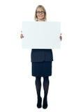 Company secretary holding blank billboard Stock Image
