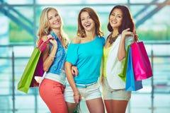 Company of shoppers Stock Photo