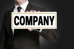 Company sign is held by businessman Royalty Free Stock Photos