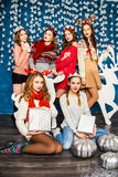 The company of six beautiful girls on the background of Christma Stock Photos