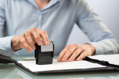 Company Stamp on Documents Royalty Free Stock Photos