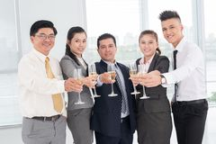 Company success. Happy businessteam celebrating company success with champagne Royalty Free Stock Photo