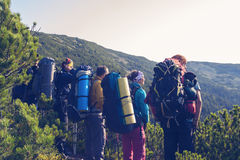 Company of travelers stands in a mountains Royalty Free Stock Photo