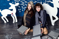 Company of two girls in blue and white Christmas decorations Stock Images