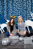 Company of two girls in blue and white Christmas decorations Stock Photos