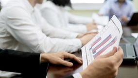 Company workers discussing report documents on table, business meeting in firm. Stock footage Royalty Free Stock Photo