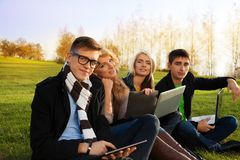 Company of young adults. Enjoying autumn days Stock Images