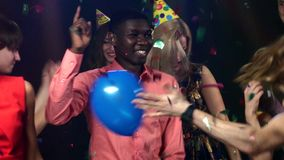 Company young and beautiful people dancing club stock footage
