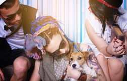Company of young hipsters with dog has good time house leisure Stock Photography