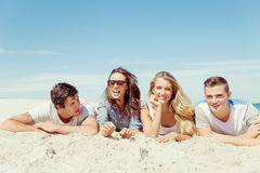 Company of young people on the beach Royalty Free Stock Images