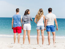 Company of young people on the beach Royalty Free Stock Photography