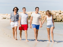 Company of young people on the beach Stock Photos