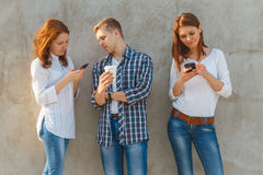 The company of young people with phone Stock Photography