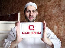 Compaq logo. Logo of computer company compaq on samsung tablet holded by arab muslim man Royalty Free Stock Photo
