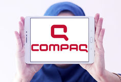 Compaq logo. Logo of computer company compaq on samsung tablet holded by arab muslim woman stock images