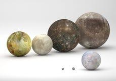 Comparaison de taille entre les lunes de Jupiter et de Neptune Photographie stock