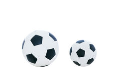 Comparative big and small football. Isolated on white background Stock Images