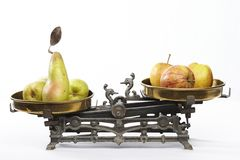 Compare apples to pears Royalty Free Stock Photos